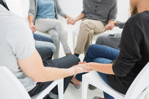 Group therapy in session sitting in a circleの写真素材 [FYI00000018]
