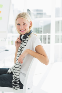 Casual young woman with headset at officeの写真素材 [FYI00000049]