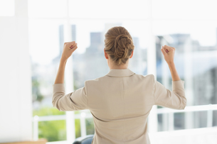 Rear of a businesswoman clenching fists in officeの写真素材 [FYI00000069]