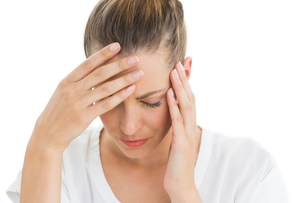 Woman having a headache with her head in her handsの写真素材 [FYI00000274]