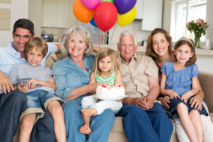 Multigeneration family celebrating girls birthdayの写真素材 [FYI00000621]