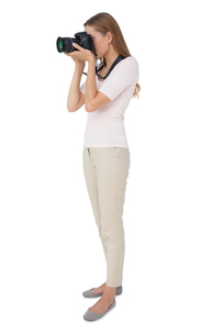 Full length side view of a woman with cameraの写真素材 [FYI00001214]