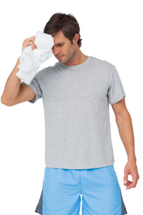 Fit young man with towelの写真素材 [FYI00001461]