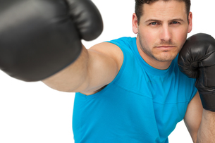 Close-up of a determined male boxer focused on trainingの写真素材 [FYI00001466]