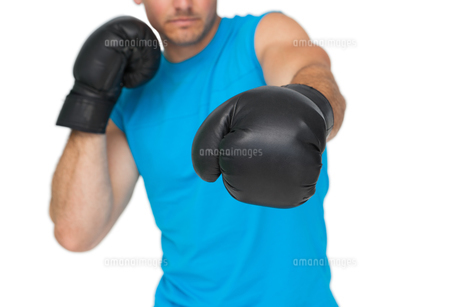 Close-up of a determined male boxer focused on trainingの写真素材 [FYI00001467]