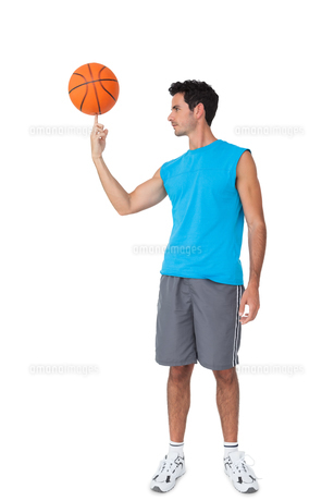 Full length of a basketball player with ballの写真素材 [FYI00001473]