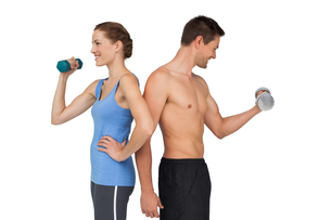 Fit young couple exercising with dumbbellsの写真素材 [FYI00001626]