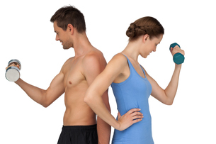 Fit young couple exercising with dumbbellsの写真素材 [FYI00001628]