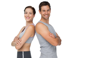 Portrait of a happy fit young couple with hands crossedの写真素材 [FYI00001638]