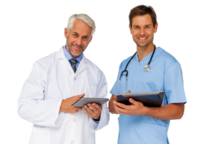 Portrait of male doctor and surgeon with digital tabletsの写真素材 [FYI00001650]