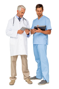 Male doctor and surgeon with digital tabletsの写真素材 [FYI00001654]