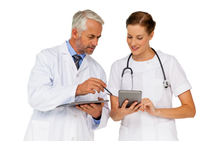 Male and female doctors with digital tabletsの写真素材 [FYI00001658]