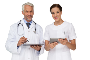 Male and female doctors with digital tabletsの写真素材 [FYI00001659]