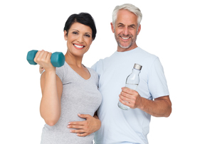 Happy fit couple with dumbbell and water bottleの写真素材 [FYI00001663]