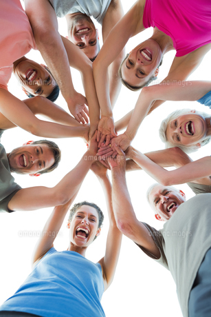 Happy sporty people holding hands togetherの写真素材 [FYI00001787]