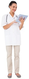 Pretty brown haired nurse using tablet pcの写真素材 [FYI00001867]