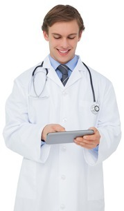 Young doctor in lab coat using tablet pcの写真素材 [FYI00001874]