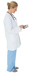 Blonde doctor in lab coat using tablet pcの写真素材 [FYI00001878]