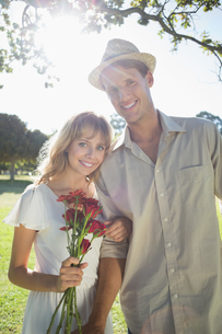 Attractive blonde holding roses standing with partner smiling at cameraの写真素材 [FYI00002005]