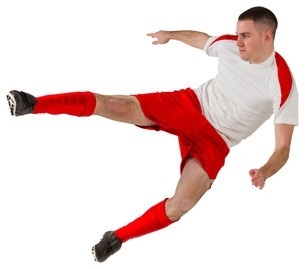 Fit football player playing and kickingの写真素材 [FYI00002021]