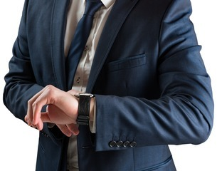 Businessman checking the time on watchの写真素材 [FYI00002124]