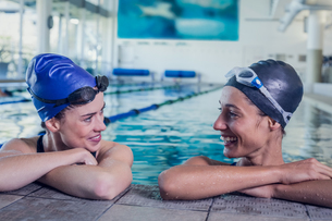 Female swimmers smiling at each other in the swimming poolの写真素材 [FYI00002171]
