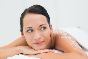 Peaceful brunette lying with salt scrub on backの写真素材 [FYI00002441]