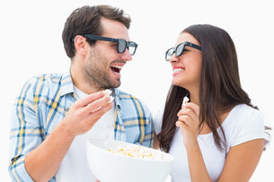 Attractive young couple watching a 3d movieの写真素材 [FYI00002615]