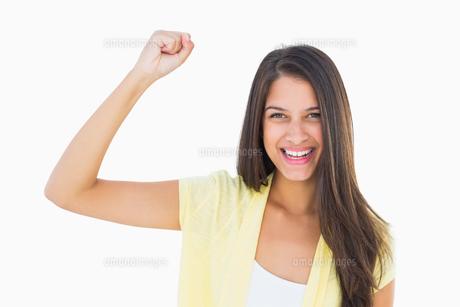 Happy casual woman cheering at cameraの写真素材 [FYI00002618]