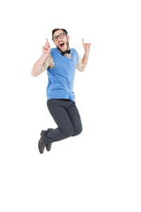Geeky hipster jumping and smilingの写真素材 [FYI00002622]