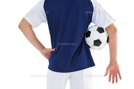 Football player in blue jersey holding ballの素材 [FYI00002623]
