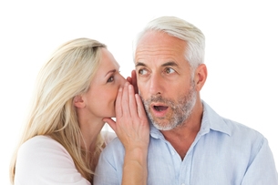 Woman whispering a secret to husbandの写真素材 [FYI00002854]