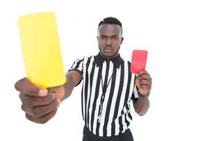 Serious referee showing yellow and red cardの素材 [FYI00003312]