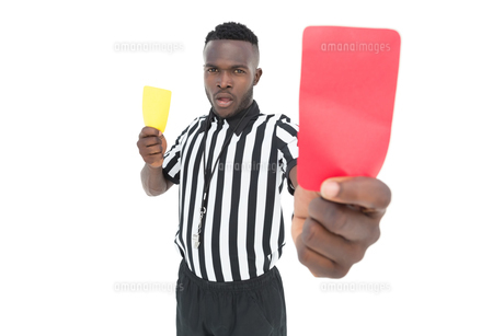 Serious referee showing yellow and red cardの写真素材 [FYI00003314]