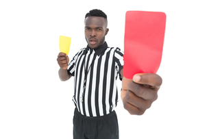 Serious referee showing yellow and red cardの素材 [FYI00003314]