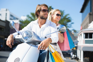 Attractive couple riding a scooterの写真素材 [FYI00003397]