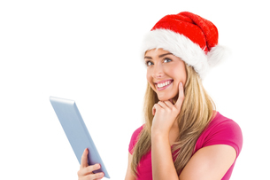 Festive blonde using tablet pcの写真素材 [FYI00003527]