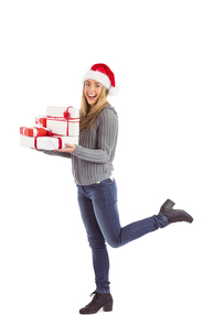 Festive blonde holding pile of giftsの写真素材 [FYI00003529]
