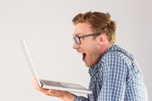 Geeky businessman using his laptopの素材 [FYI00003536]