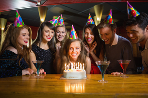 Friends celebrating a birthday togetherの写真素材 [FYI00003692]