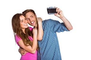 Couple taking selfie with digital cameraの写真素材 [FYI00003900]
