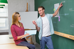 Creative business people at work against blackboardの写真素材 [FYI00004039]
