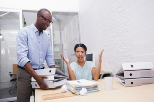 Businesswoman surprised with stack of folders at deskの写真素材 [FYI00004091]