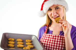 Festive blonde showing hot cookiesの写真素材 [FYI00004294]