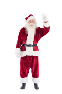 Jolly Santa waving at cameraの写真素材 [FYI00004416]