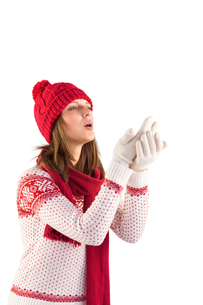 Woman in warm clothing blowing over handsの写真素材 [FYI00004507]