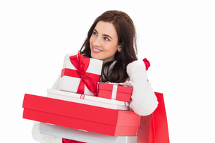 Happy brunette holding christmas gifts and shopping bagsの写真素材 [FYI00004515]