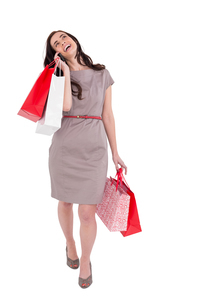 Happy brunette with shopping bags on the phoneの写真素材 [FYI00004536]