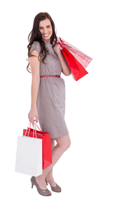 Elegant brunette posing with shopping bagsの写真素材 [FYI00004537]