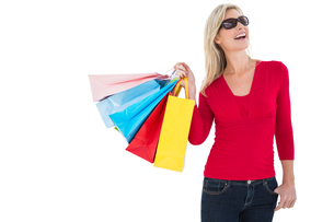 Happy blonde holding shopping bagsの写真素材 [FYI00004539]